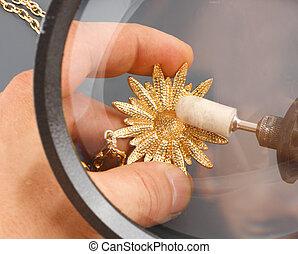 The jeweler polishing gold - Polishing gold, view through...