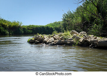 The Jordan River, Israel - View of the slow river flow and...