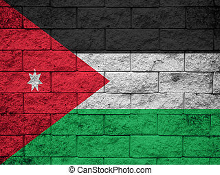 The Jordanian flag painted on grunge wall