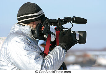 journalist with a videocamera - The journalist with a...
