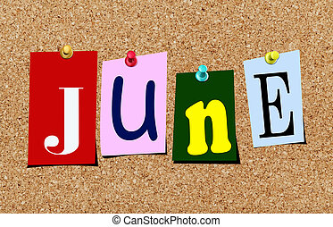 The june magazine cutout letters pinned to cork noticeboard