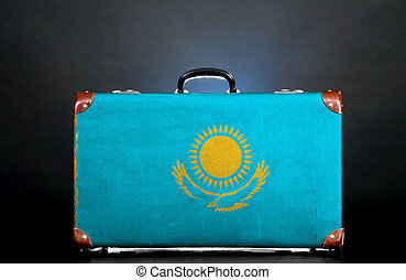 The Kazakh flag on a suitcase for travel.
