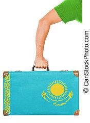 The Kazakh flag on a suitcase. Isolated on white.