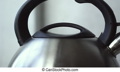 The kettle with boiling water - Tea kettle with boiling...