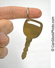 the key - golden key hanging from fingertip