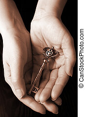 The key of love - Palms holding a key with engraved word ...