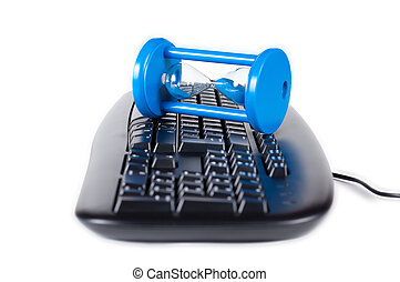 The keyboard with a sand-glass isolated on a white background.