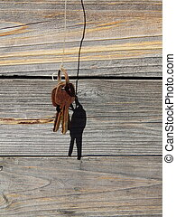 The keys hang on the rope