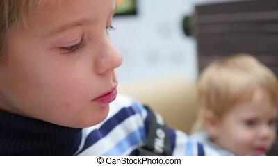 the kid eats a fried potato at a fast food restaurant closeup
