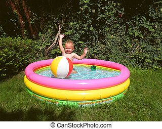 The kid in an inflatable pool