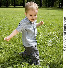 The Kid Running On A Meadow