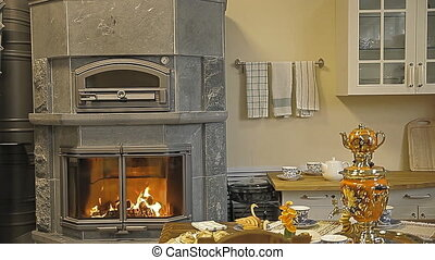 The kitchen, in the kitchen there is a fireplace-stove and a...