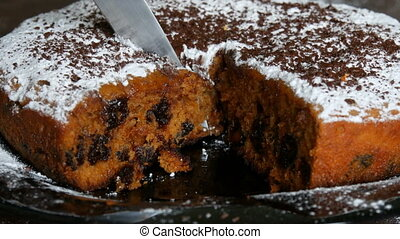 The knife cuts piece of delicious freshly baked cherry cake ...
