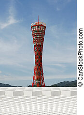 The Kobe Tower is a landmark in the city of Kobe. Rising above a series of geometric shapes, the tower stands out against the sky.