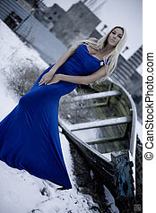 The lady in a blue dress on snow