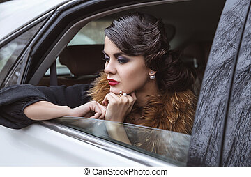 The lady in the car. - Thoughtful brunette in the back seat...