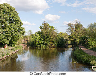 the lake at flatford mill outside in the country in essex on a bright and clear sunny day with no people location and holiday tourist spot with natural beauty