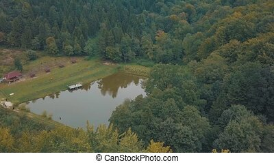 The Lake in the middle of a forest. View from the top. Autumn. Aerial