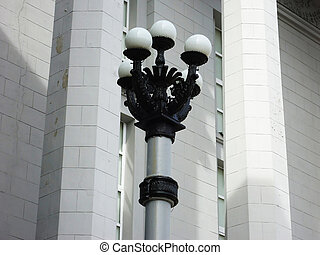 The lantern against a white wall