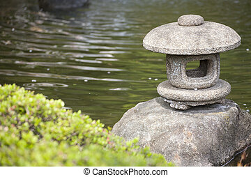 The Lantern rock of japan style in the garden