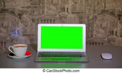 the laptop is on the table,  a Cup of coffee. chromakey