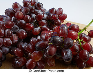 The large bunch of ripe red grapes