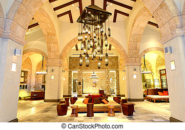 The large chandelier at lobby in luxury hotel in night...