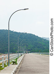 the largest dam in Penang, Malaysia. - Road on dam ridge in...