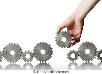The Last Part - Man adding a cog gear wheel to a row.