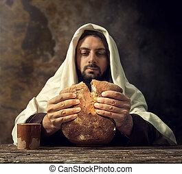 The Last Supper, Jesus breaks the bread.