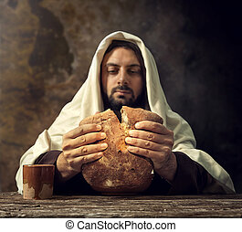 The Last Supper, Jesus breaks the bread.