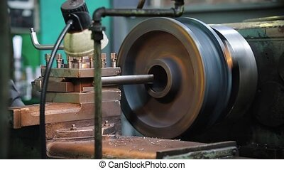 The lathe begins its work. Metal rod turning - mid shot