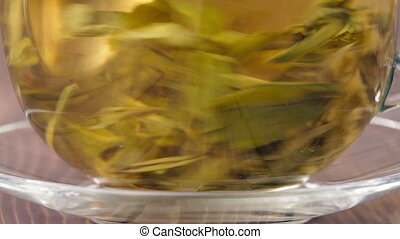 The leaves green tea and tea particles. Macro shot