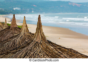 The leaves of brown thatched roof in asian style on the beach