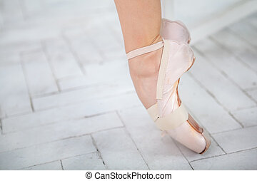 the leg of a ballerina on white background