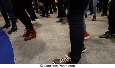 legs of a group of dancing people