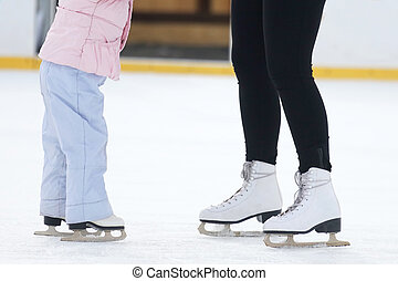 the legs of a man skating on an ice rink