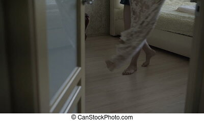 The legs of a woman on the floor in the room
