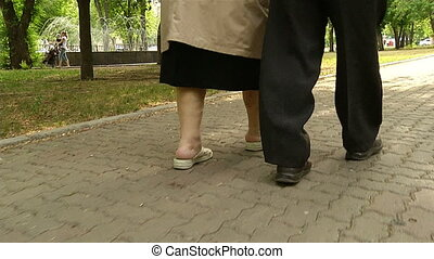 The legs of the two older men