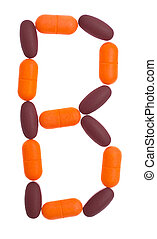 The letter B  alphabet made of medical tablets