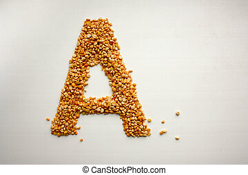 The letter c . English alphabet from cereals. peas.