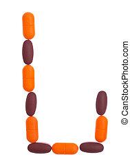 The letter L  alphabet made of medical tablets