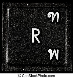 The letter R from a black computer keyboard