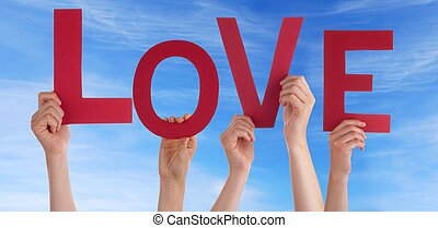 People Holding the Red Letters Love