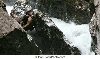 The Liechtensteinklamm gorge with stream and waterfalls in...