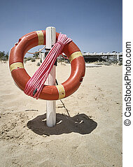 The life buoy hanging on the beach
