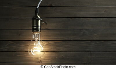 The light bulb slowly lights up, quickly flickers on a...