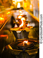 The light from the oil lamp.