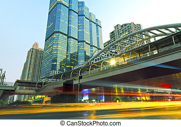 The light trails of the cars in the modern city