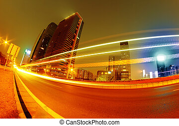 light trails - the light trails on the modern building ...